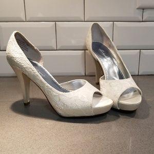 Michaelangelo Leighton Heels